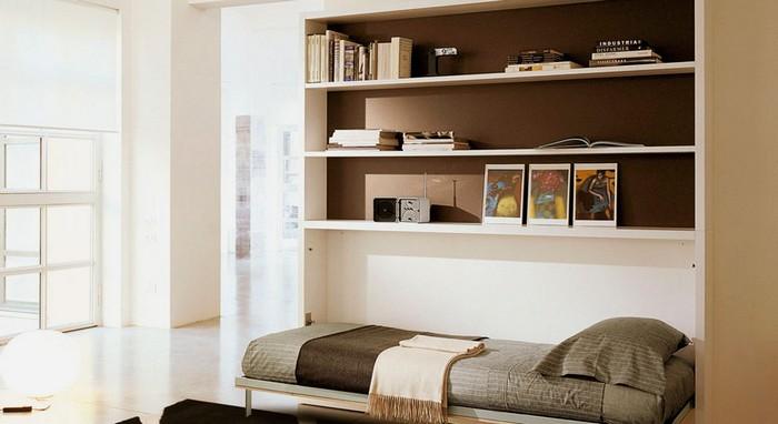 Подъемная кровать в интерьере комнаты