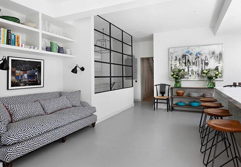 Большая кухня с белыми стенами и диваном