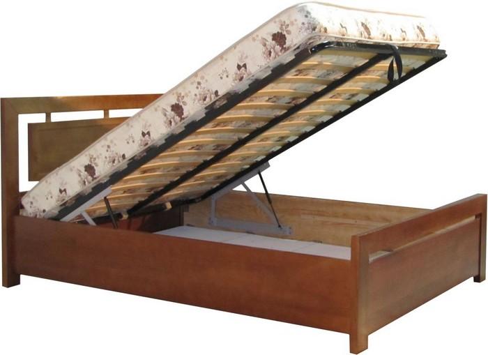 Подъемный механизм у деревянной кровати