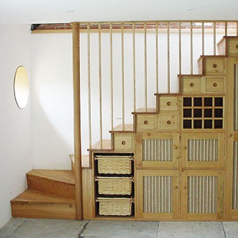Фото необычного шкафа под лестницей. Подойдет для дачи или для загородного дома