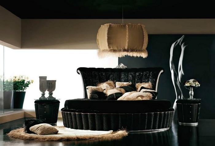 Круглая кровать с обивкой из черного бархата