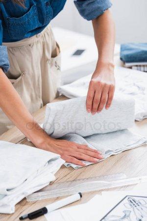 Cropped Image Female Fashion Designer Folding Shirt Table Clothing Design — стоковое фото