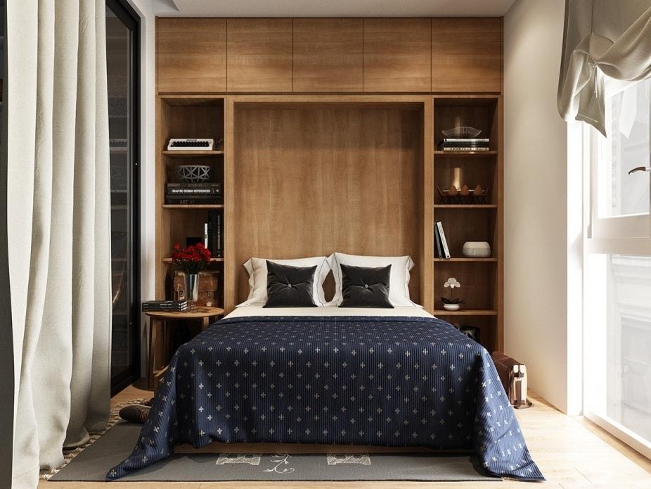 Навесные настенные шкафы, которые располагаются над кроватью несут декоративную и функциональную задумку
