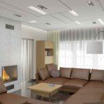 угловой диван коричневого цвета в интерьере