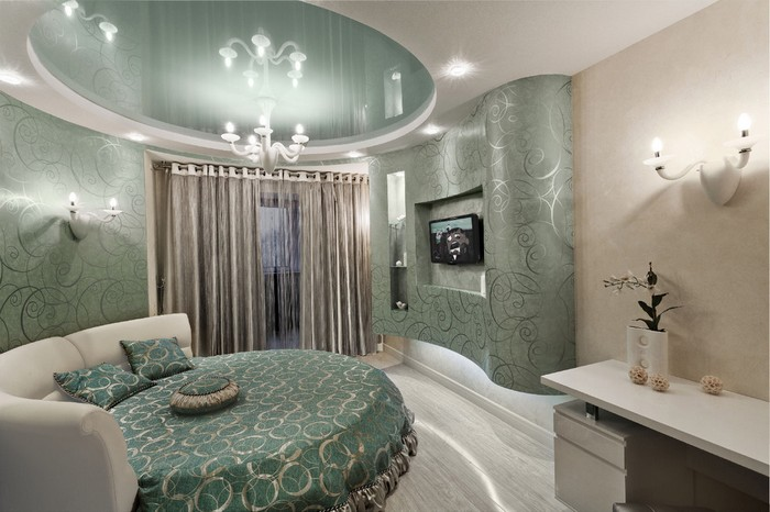 Интерьер зеленой спальня с круглой кроватью