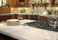 Искусственный камень занимает высокие позиции в кухонном интерьере.