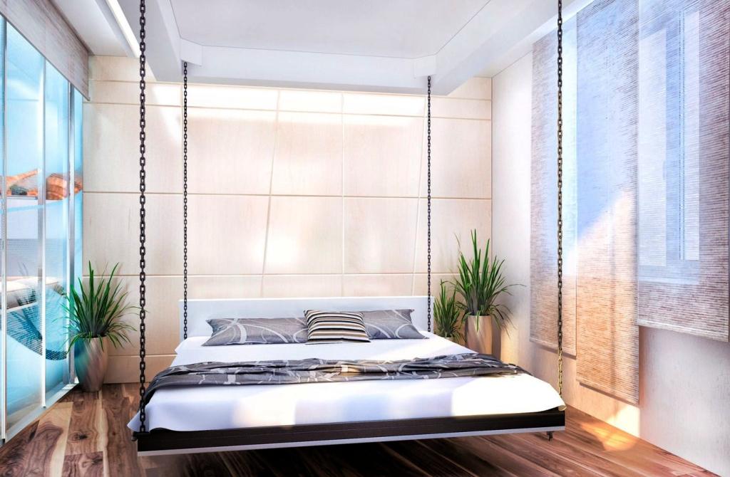 Парящая подвесная кровать на канатах в потолке